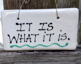 It is what it is hanging sign.