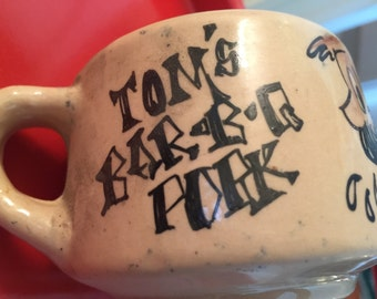Antique Cartoon Mug Tom's Bar B Q Pork Palm Springs California Vitrified Mug The Mug Shop of Corona Del Mar