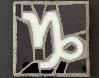 Capricorn zodiac sign mosaic, white and black