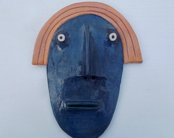 Mini Flathead Wall piece with yellow pageboy hair, blue face