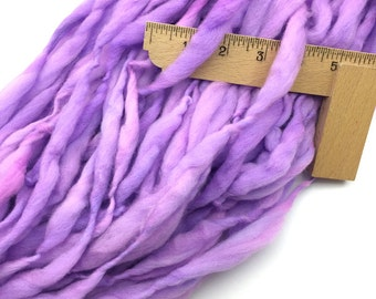Thick and thin handspun lavender yarn spun in merino wool, super bulky weight, 54 yards 3 ounces/ 86 grams