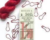 Knitters' travel tins with stitch markers