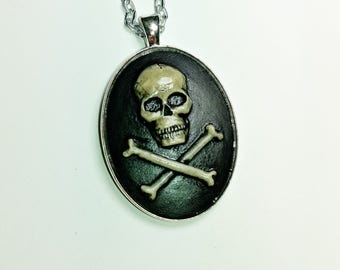 Skull and cross bone cameo necklace on 30 inch chain.