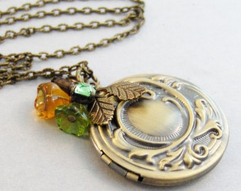 In the Meadow,Locket,Brass Locket,Topaz Jewelry,Topaz Necklace,Peridot Jewelry,Peridot Necklace,Green and Yellow,Yelow Necklace,valleygirld