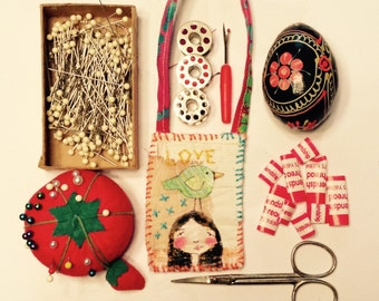 Small textile ornaments, mini art quilts