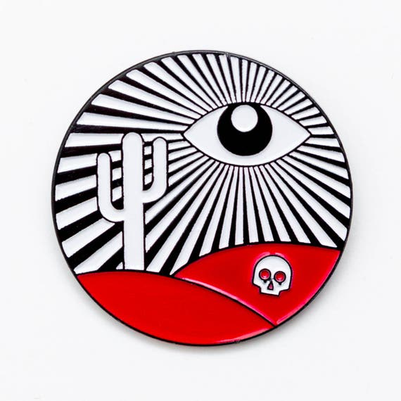 The truth is nowhere enamel pin. All seeing eye paranormal desert skull lapel pin.