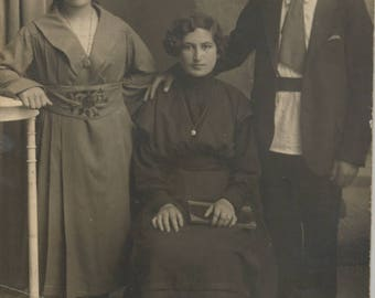 Vintage Photo Postcard of Two Young Women and Man this is a RPPC 1900s