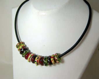 A Lot of Glass Beaded Necklace with Thick Black Leather Cord, Green, Black, Ivory and Red