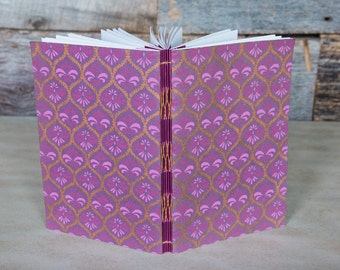 Large sketchbook with purple fleur-de-lis covers