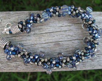 Blues at midnight jumbled Kumihimo bracelet with custom glass drops and textured silver