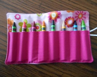 Pink hot pink orange limegreen flowers crayon roll up 8 count