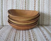 A Set of Six Oval Wooden Salad Bowls