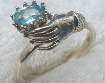 Blue Zircon Art Nouveau Ladies Gloved Hand ring, recycled sterling silver, December Birthstone, brighter than aquamarine like blue diamond