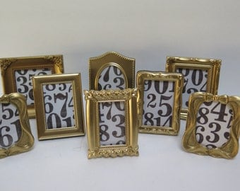 8 small table number gold picture frames easel backs to stand on table top