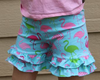 flamingo print turquoise shorties  sizes 12m - 14 years.