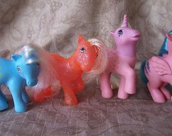 Vintage group of 4 My Little Ponies.  CF457-12