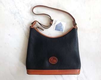 Dooney and Bourke navy blue and tan crossbody