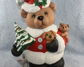 Hand Painted Christmas Cuddle Bears all dressed in their Santa outfits and holding a Christmas tree