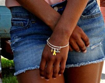 Yellow Ribbon Awareness Charm Bracelet: Sarcoma/Bone Cancer, Soldier support, Spina Bifida, Missing Children, Bladder Cancer