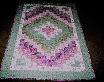 Crib Size Quick Trip Around the World Quilt in Shades of pink and pastel green