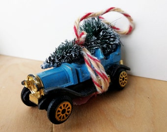 Ole Time Blue Matchbox Car with Tree Strapped to the Top Ornament by Distinguished Flamingo