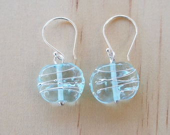 Recycled glass earrings with fine silver wire. Recycled Glass Beads made from a wine bottle