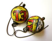Don't Let Anybody Tell You Different -primitive vintage assemblage soldered yellow red salsa tin hollow scratch bauble black metal earrings