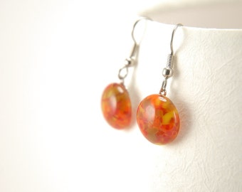 Red and orange patterned fused glass dangle earrings with surgical steel earwires, carnelian red round drop earrings, glossy / shiny finish