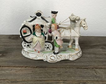 Vintage horse drawn carriage and Victorian Couple hand painted china figurine