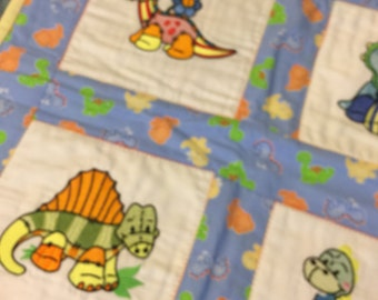 NEW Baby or Lap quilt with DINOSAURS embroidered on it