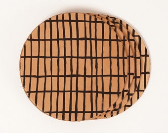 Leather drink coasters with hand painted grid pattern detail | JIG