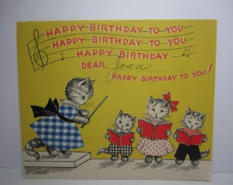 Very sweet 1936 art deco Norcross birthday card cat in real blue and white fabric plaid dress and 3 kittens singing happy birthday to you,