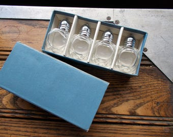 4 small salt and pepper shakers in box