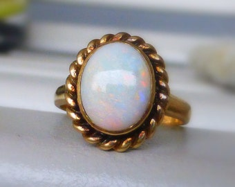 Old 14k Solid Fire Opal Cabochon ring with ornate undergallery. Nice colors!