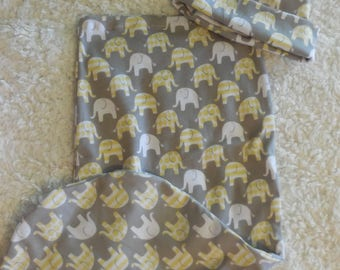 Swaddle bag (cocoon) and hat set. Made from stretch knit. Cute elephants make this set gender neutral.