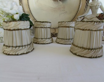 Vintage French set of four lovely clip on lampshades.  Off white with green trim.