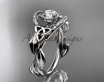 """Platinum diamond celtic trinity knot wedding ring, engagement ring with a """"Forever One"""" Moissanite center stone CT7326"""