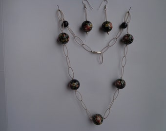 Silver chain bead necklace with earrings.