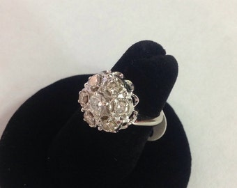 Ladies diamond cluster style engagement ring