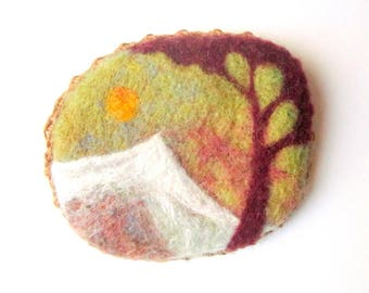 Needle felt brooch, miniature art piece with tree and mountain landscape.