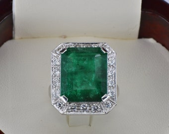 Glamorous huge 12.77 Ct natural emerald and diamond one off vintage ring