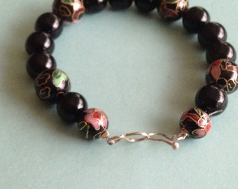 Black Onyx and  cloisonné  beaded bracelet with sterling silver holk clasp.