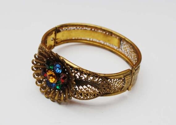 https://www.etsy.com/listing/517182575/art-deco-nouveau-gold-filigree-flower?ga_search_query=flower&ref=shop_items_search_77