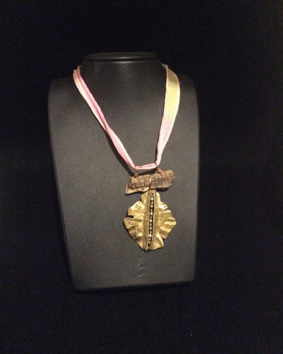 Fold formed, brass pendant, channel with pearls, organic wood jewelry, silk ribbon.