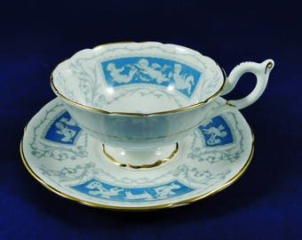 Coalport Revelry Cup and Saucer, Vintage Bone China, White Porcelain with Blue, Playing Cherubs, Saucer has Gosts and Cherubs, Gold Rimmed