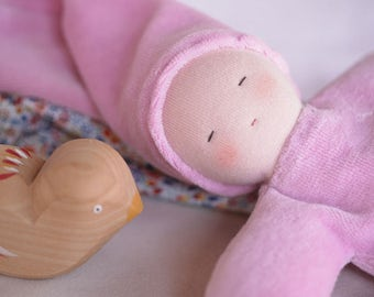 Set of waldorf toys for baby, pink cuddle waldorf doll and a little rocking bird.