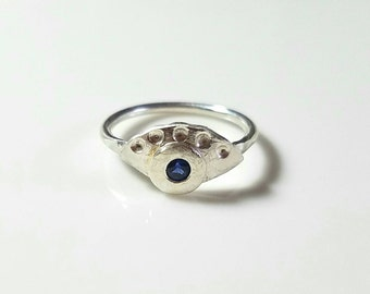 One of a kind sterling silver eye ring with 3mm sapphire, size 6.75