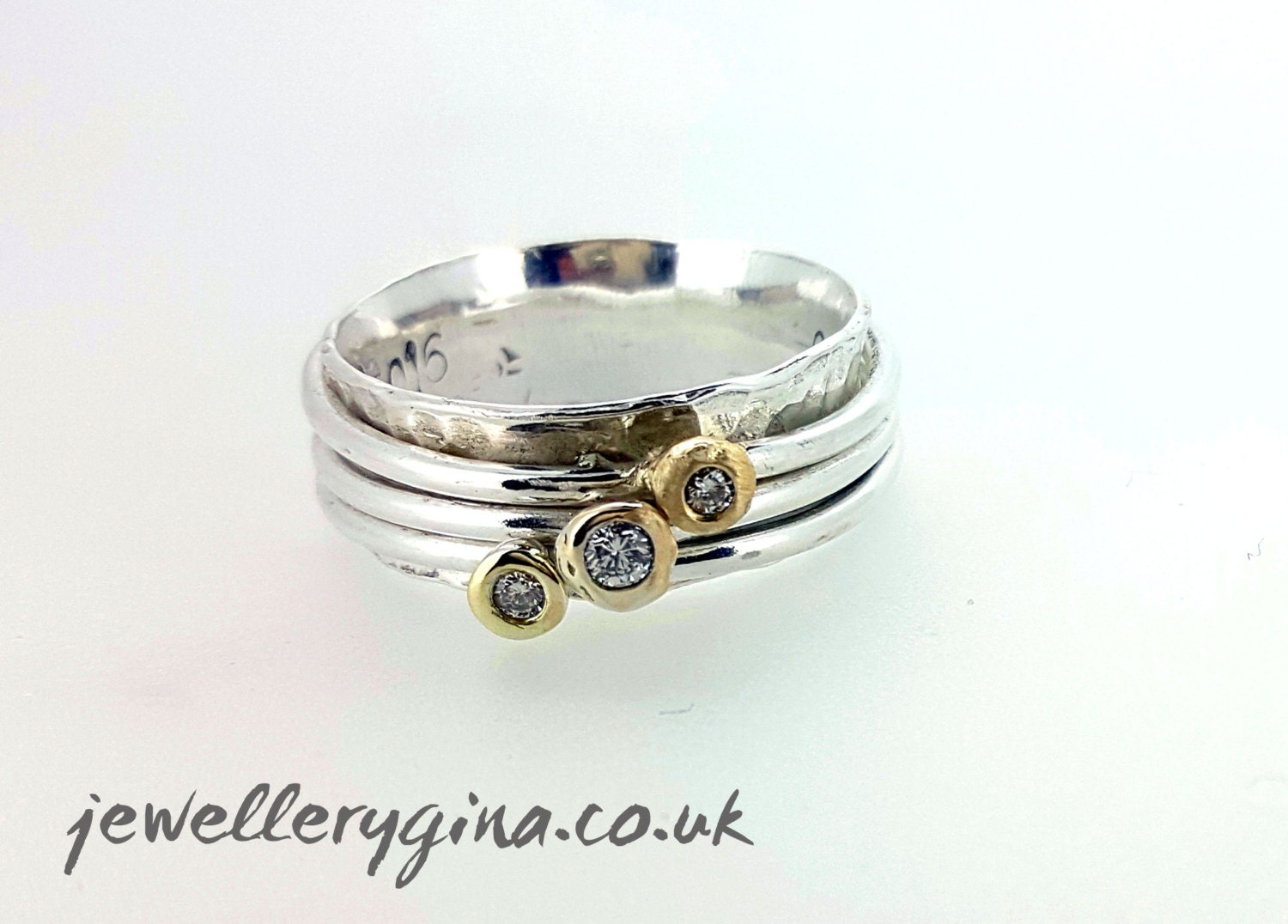 cariad ring silver spinning rings set with diamonds