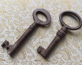 Skeleton keys, 2 different, antique.   Two keys for opening boxes etc., 1 is cast iron, c 1800, & the other steel c 1900 thereabouts.
