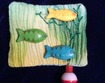 Fishing school pin brooch